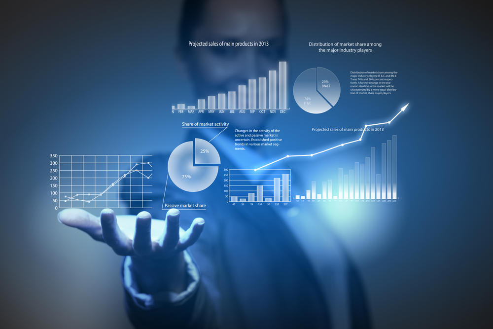 Close up of businesswoman holding graphs in hand-1